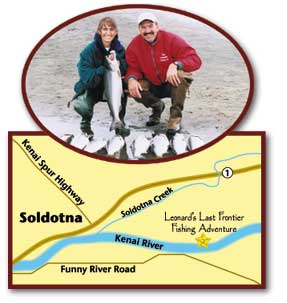 Man and woman with a bunch of Salmon fish and a map of how to get there.